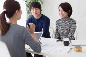 Asian-Chinese-couple-talking-to-Consultant
